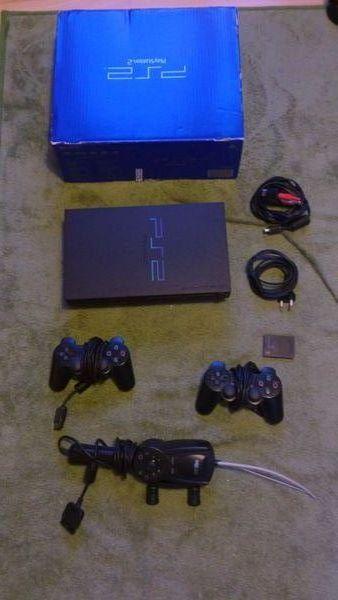 PS2 + accessoires + 2 manettes + 52 jeux + 35 démos  0 Montauban (82)