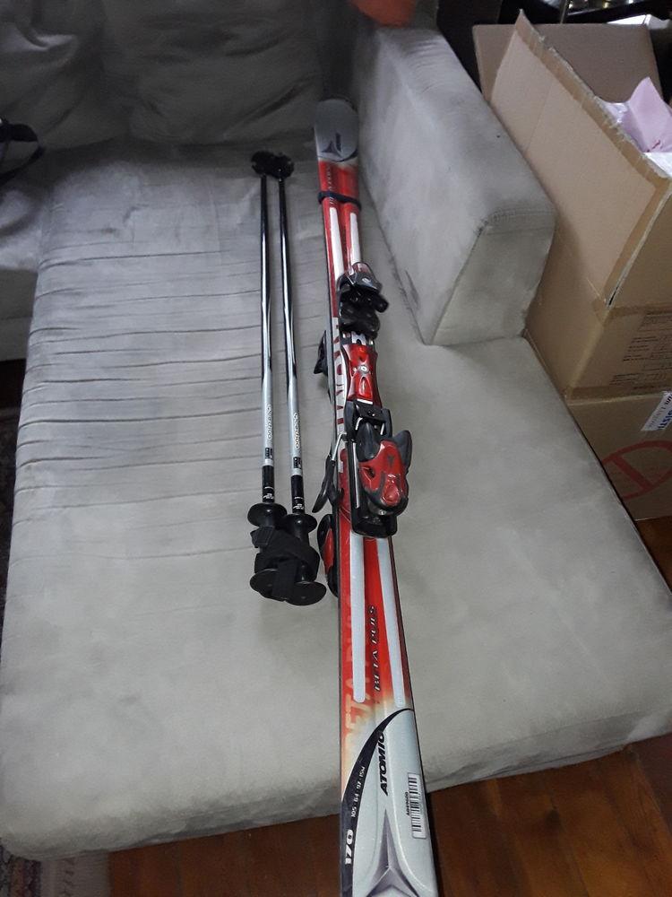 Ski Atomic 80euros servi une semaine avec bâtons et housses Sports