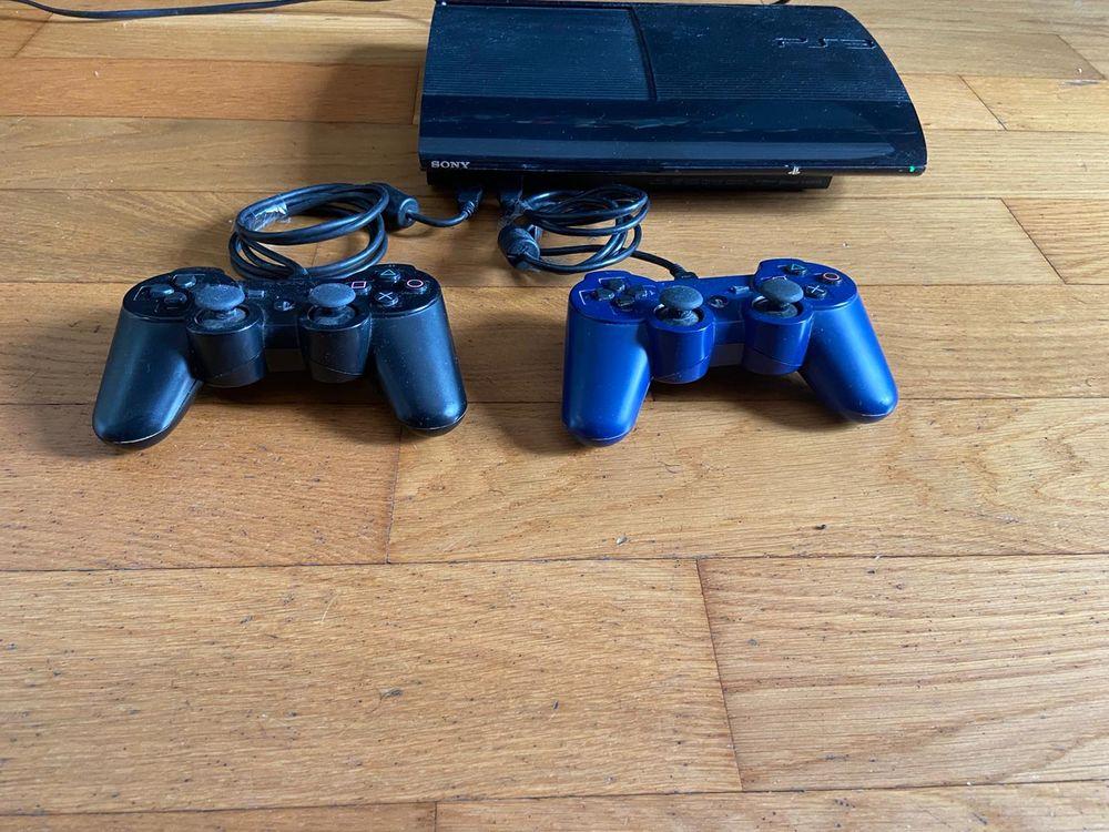 PS3 avec 2 manettes et jeux 150 Paris 15 (75)
