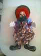 Beau clown Bras et Jambes articules  porcelaine