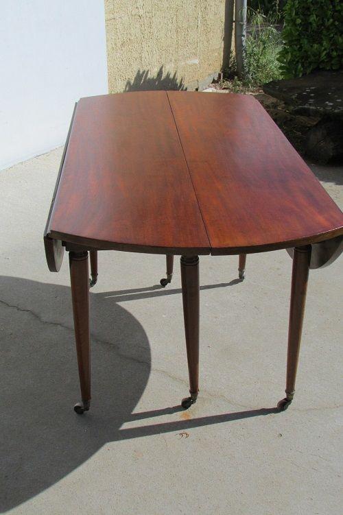 Belle table ronde 6 pieds fuseaux en acajou, extensible 620 Paris 20 (75)