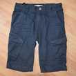 10 ans. Bermuda bleu marine. Très bon état. Vêtements enfants