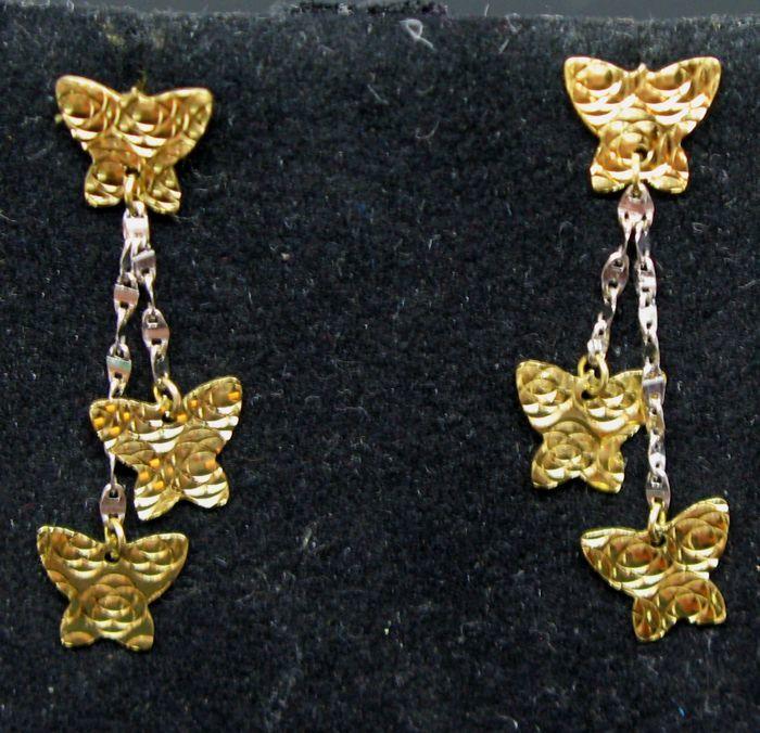 BOUCLES D'OREILLES EN OR JAUNE et OR BLANC 18 CARATS Bijoux et montres