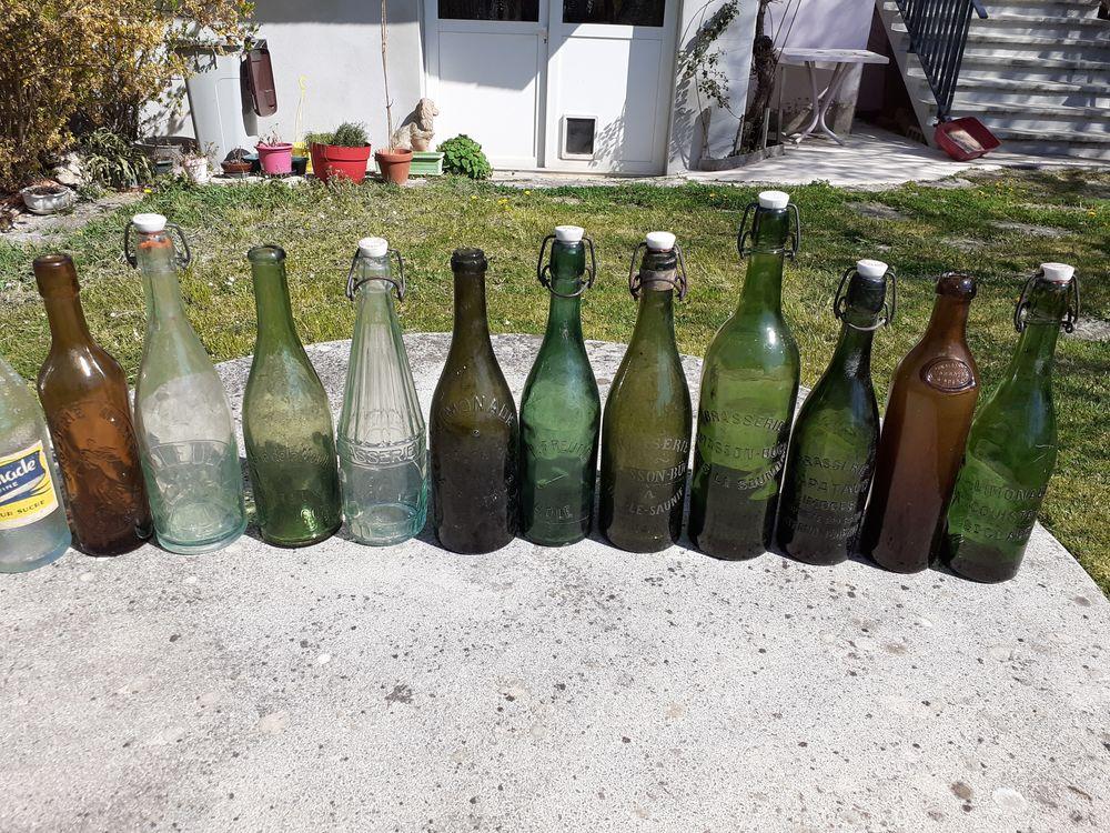 12 Bouteilles diverses LIMONADE ou BRASSERIE . 40 Le Vernois (39)