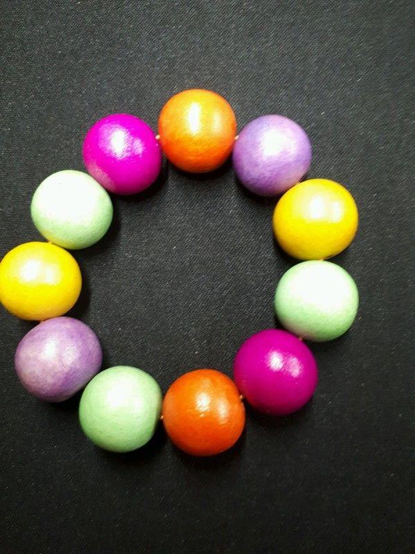bracelet avec boules en bois multicolore 1 La Ferté-sous-Jouarre (77)