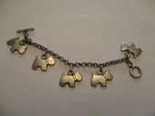 bracelet avec motifs des petits chien longueur totale 18 cm 0 Mérignies (59)