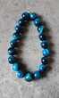 bracelet double élastique avec pierre oeil de chat bleu,