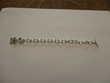 bracelet fantaisie petite fleur sur le bout longueur 18 cm