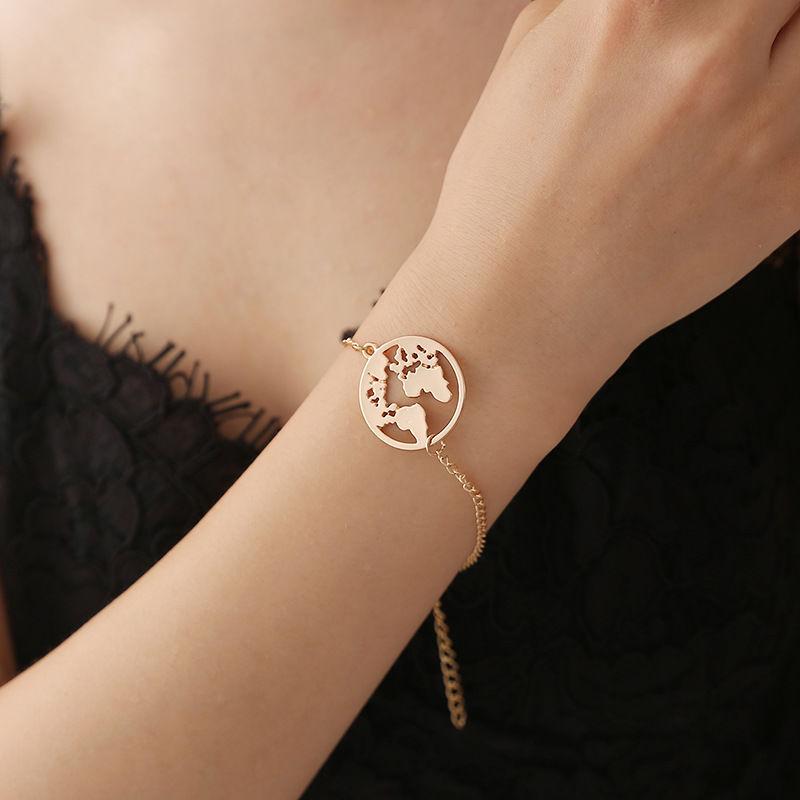 59 bracelets mapmonde or/argent Bijoux et montres