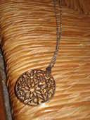 chaîne ou collier avec un rond étoilé 0 Mérignies (59)