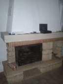 cheminée en pierre du gard et sa poutre chêne 150 Biot (06)