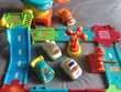 Circuit + 4 véhicules Jeux / jouets