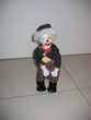 Clown automate mécanique porcelaine.