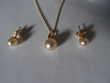 collier pendentif boucles d'oreille et bague Bijoux et montres