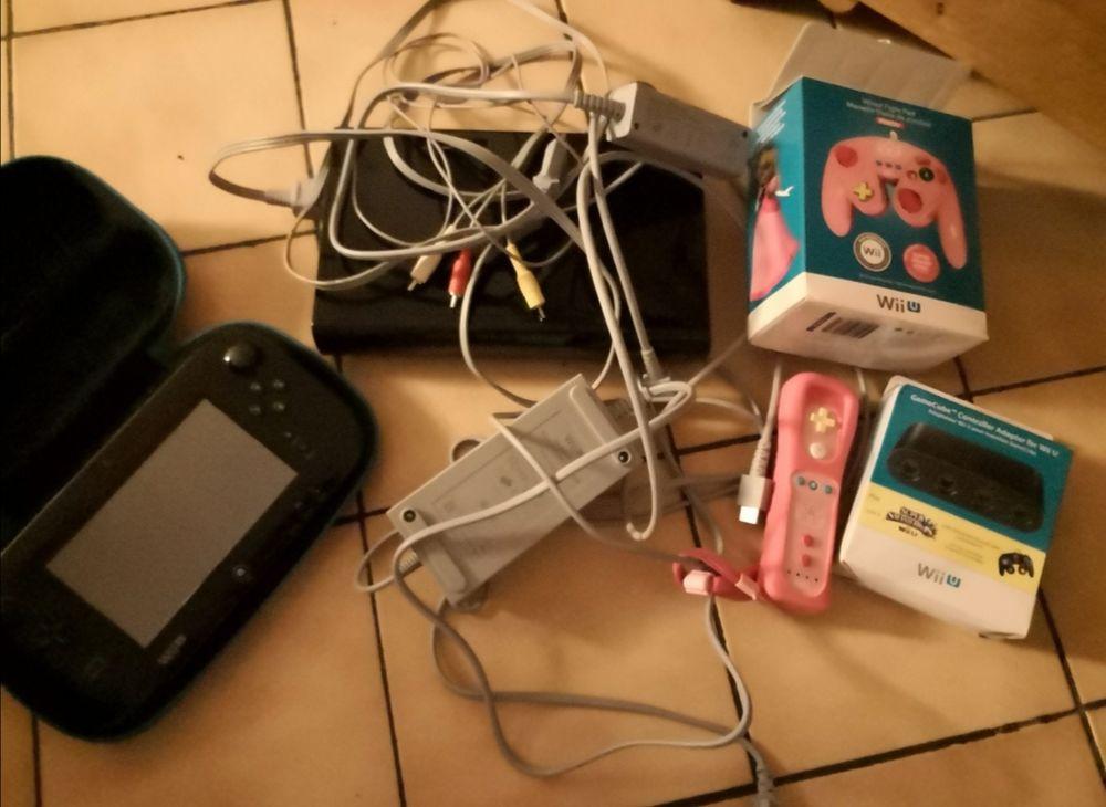 Console Wii U avec ses accessoires 90 Chelles (77)