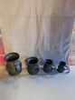 4 cruches en étain Décoration