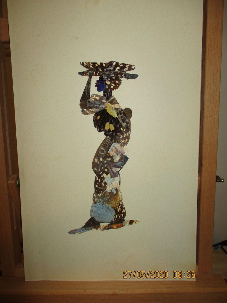 FEMME AFRICAINE - PORTEUSE Ailes de Papillon 40 La Réunion (97)