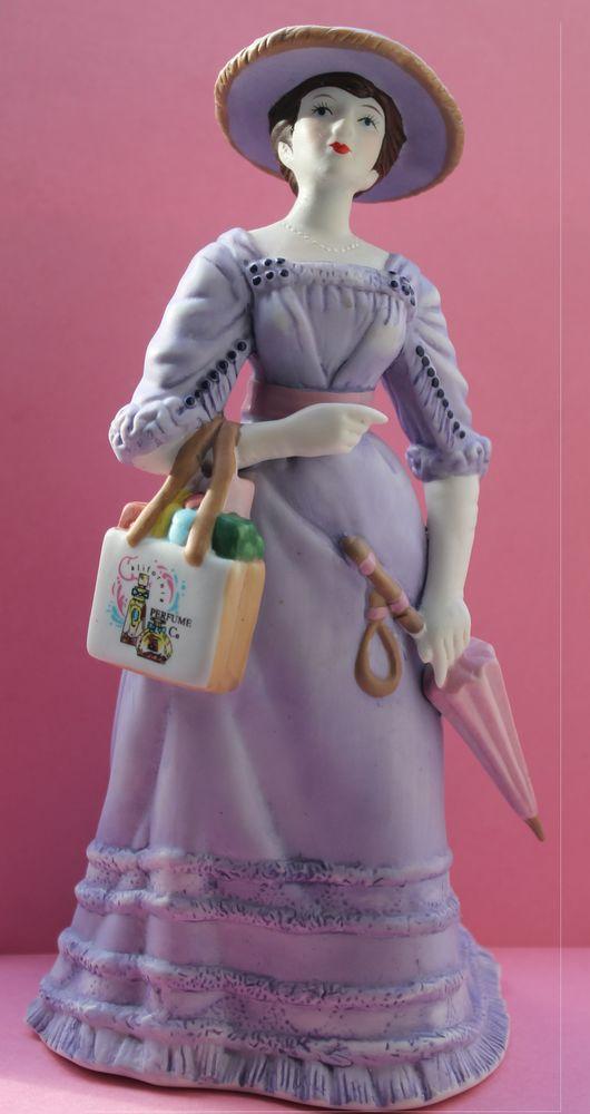Figurine porcelaine  Miss Albee la fille aux parapluie  Avon 35 Vitry-sur-Seine (94)