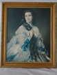 1 grand tableau représentant une femme.