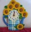 Horloge pendule murale en résine décor bouquet de tournesols