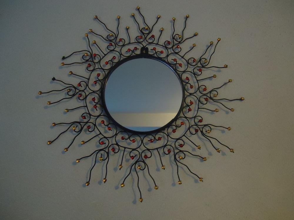 Miroir soleil en fer forgé  6 Doué-la-Fontaine (49)