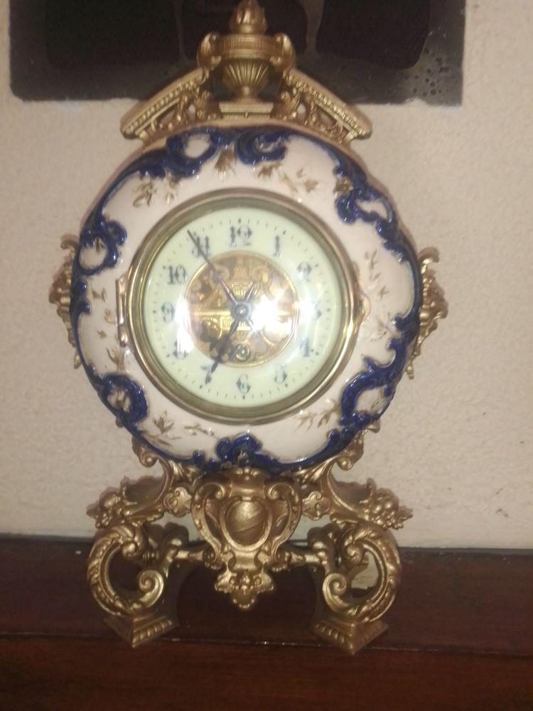 Pendule porcelaine XIX eme 400 Belley (01)