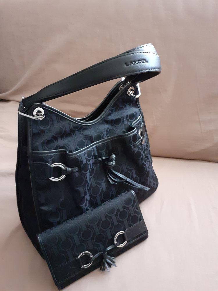 sac et portefeuille de marque Lancel  100 Genas (69)