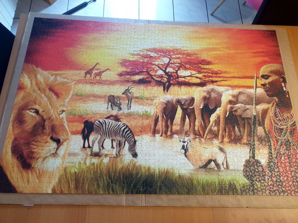 Puzzle 3000 pièces guerriers massaï et animaux de la savane. 25 Vauréal (95)