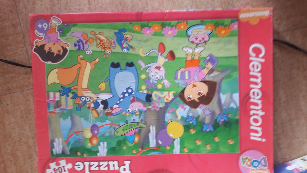 2 puzzles dora Jeux / jouets