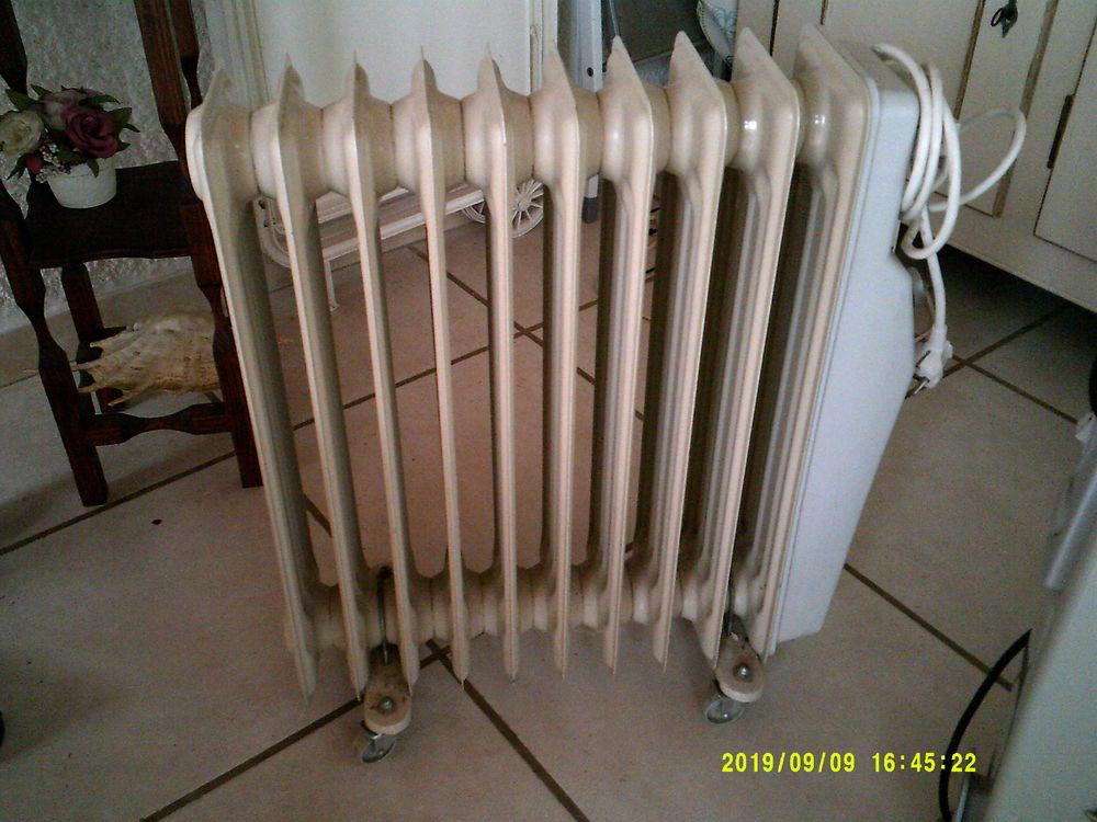 radiateur bain d'huile tres peu servi ,encore sous gar Electroménager
