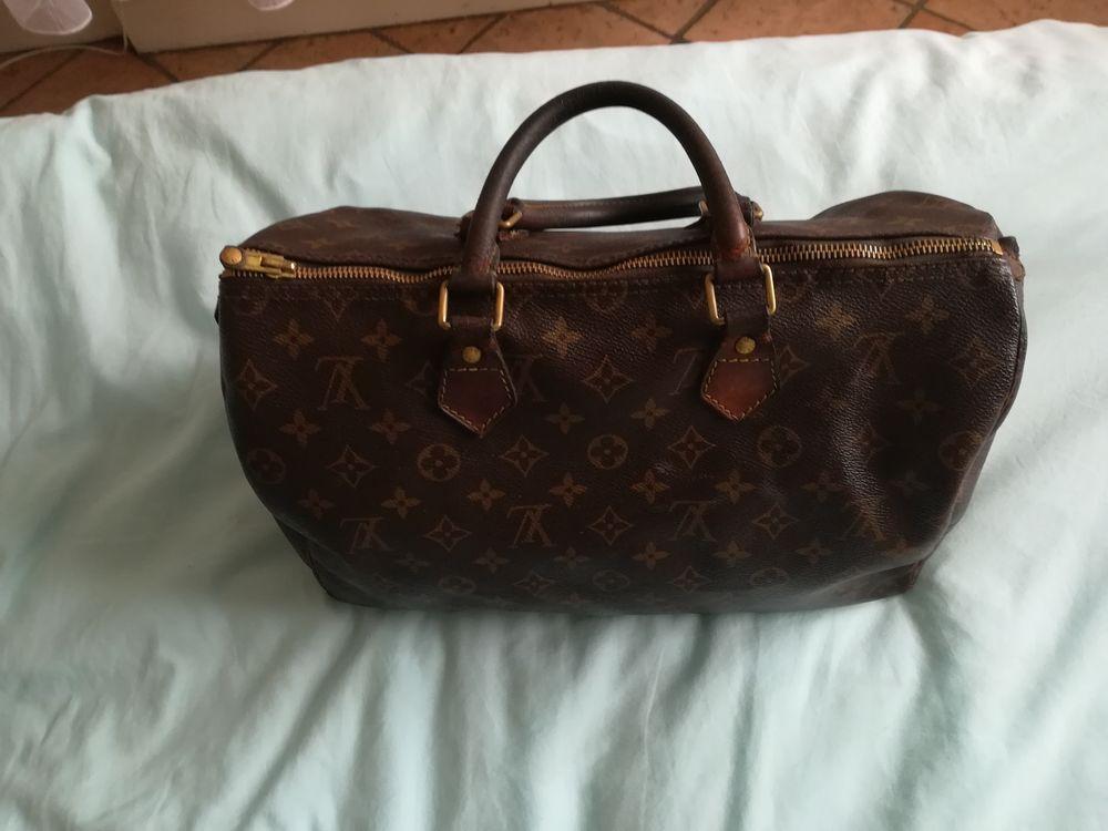 recherche sac de marque Vuitton chanel 100 Melun (77)