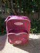 sac à dos à roulette de couleur violet prune