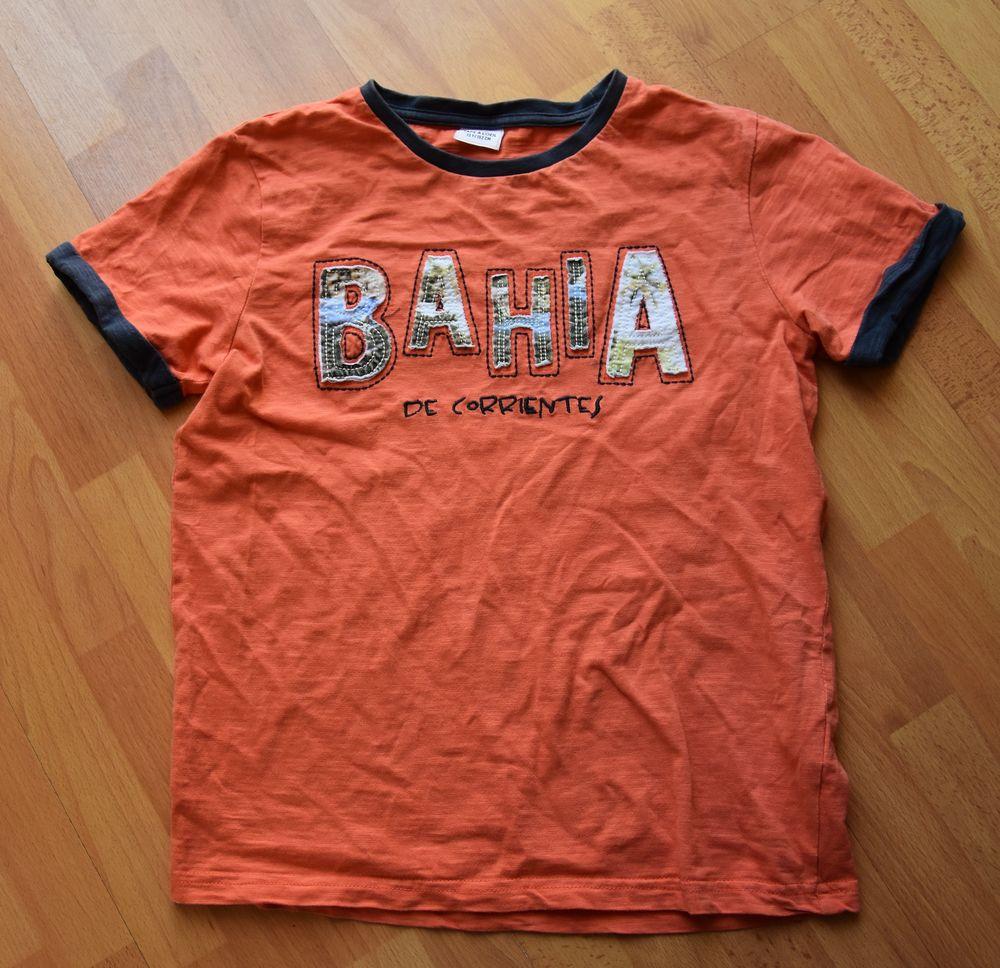 12 ans. Tee shirt orange. Tape à l'oeil. Très bon état.  3 Gujan-Mestras (33)