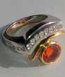 Splendide bague en or 18 carats avec une Opale de feu