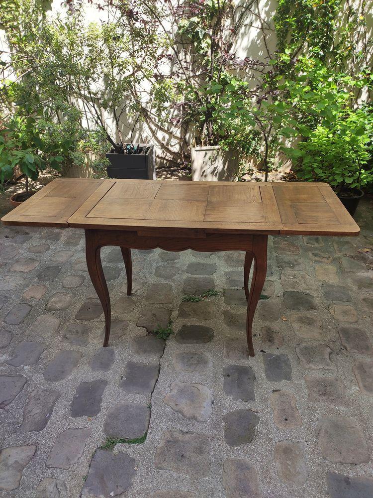Table à rallonges en chêne massif. 0 Paris 14 (75)