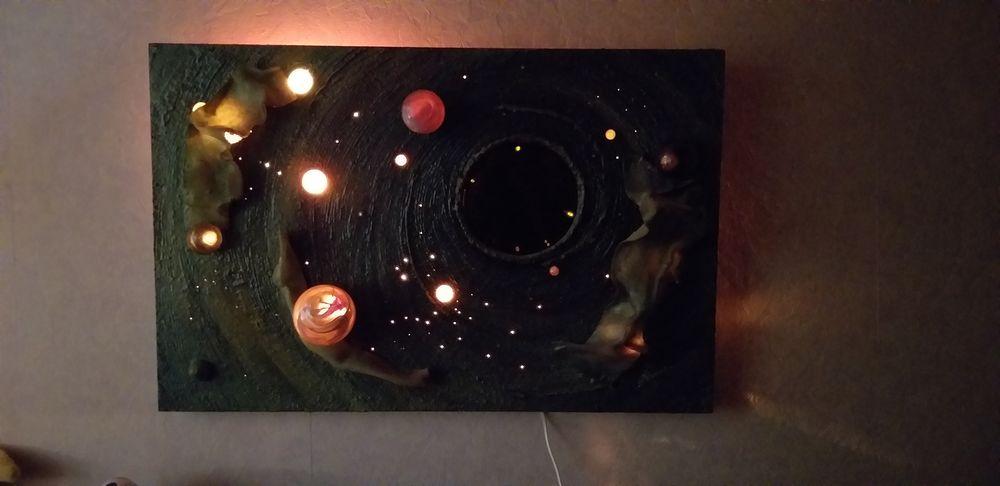 Tableau intitulé : Espace galactique signé :  GIL ARIANE 350 Vitry-sur-Seine (94)