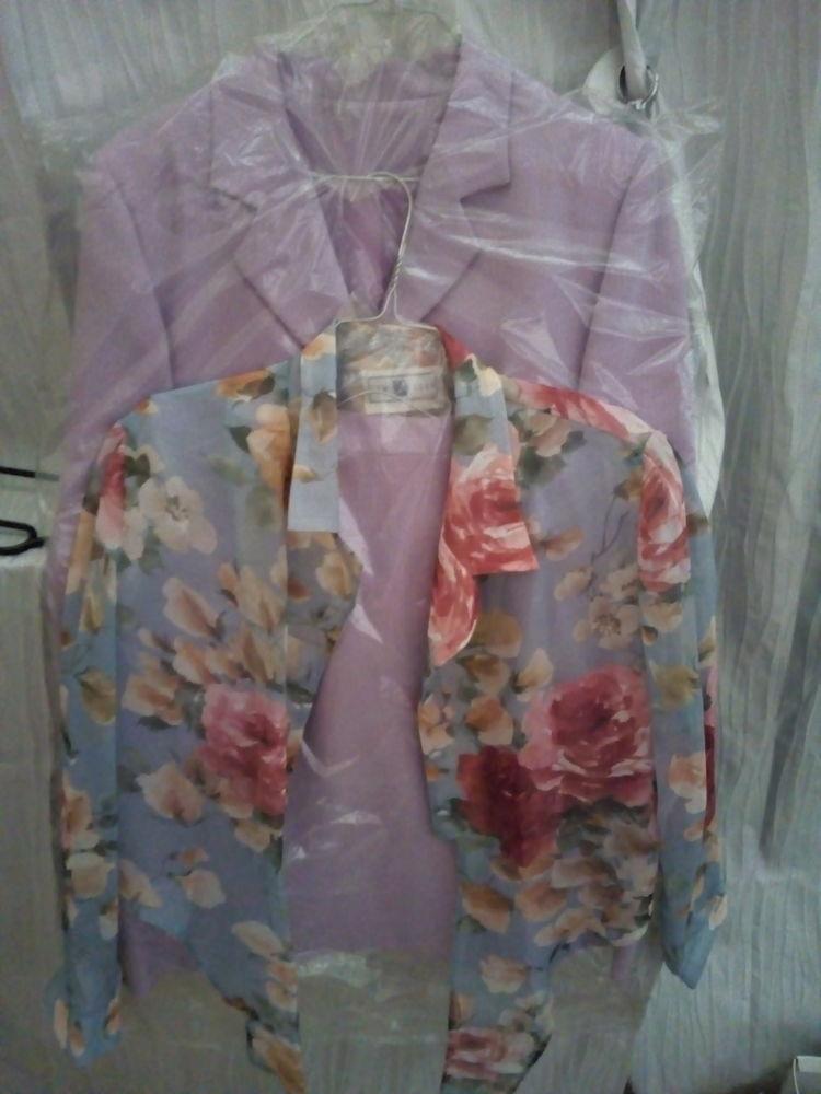 Tailleur jupe taille 42 couleur parme 12 Savigny-sur-Orge (91)