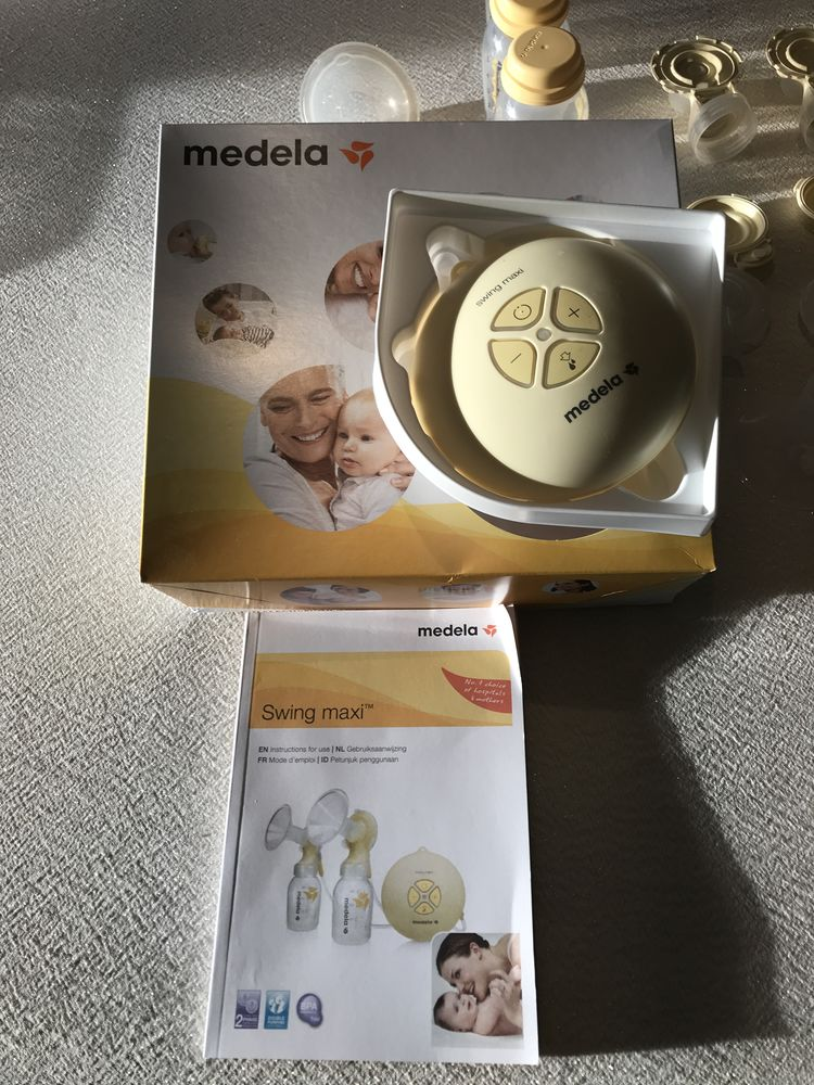Tire lait medela swing maxi double Puériculture