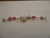 très joli bracelet fantaisie longueur 20 cm avec motifs  0 Mérignies (59)