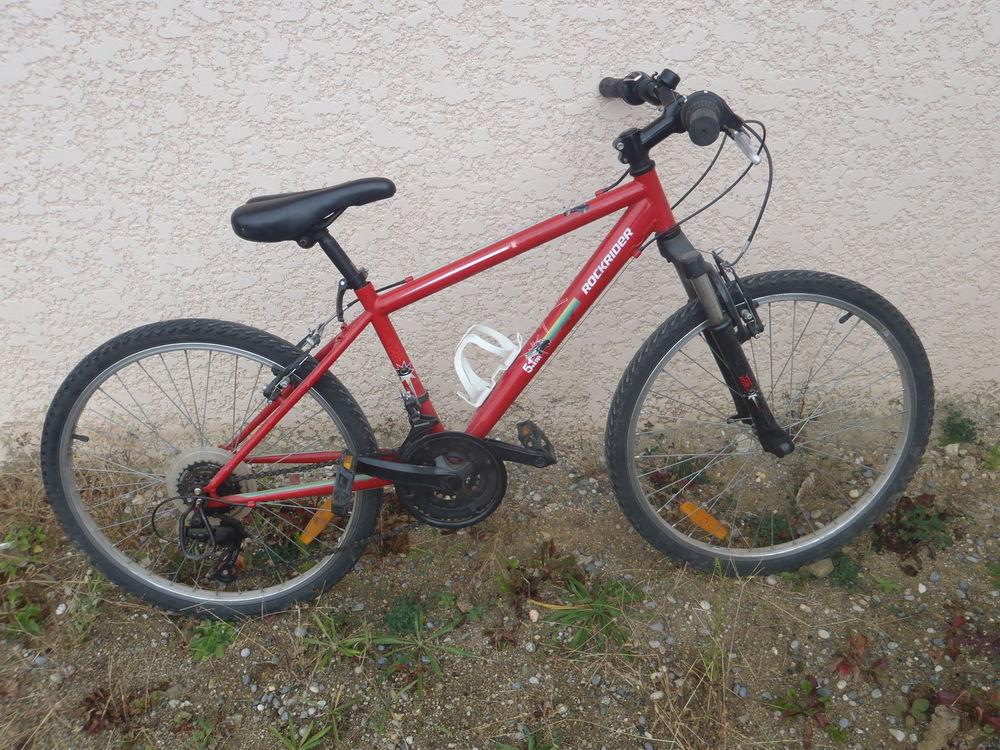 Vélo Rockrider  rouge. 65 Ozon (07)