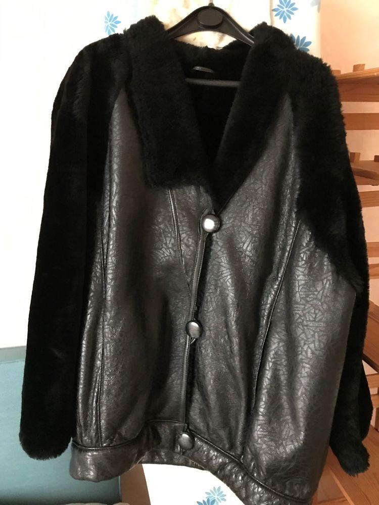 Veste en cuir et fourrure noire, de forme blouson, taille 44 50 Chalon-sur-Saône (71)