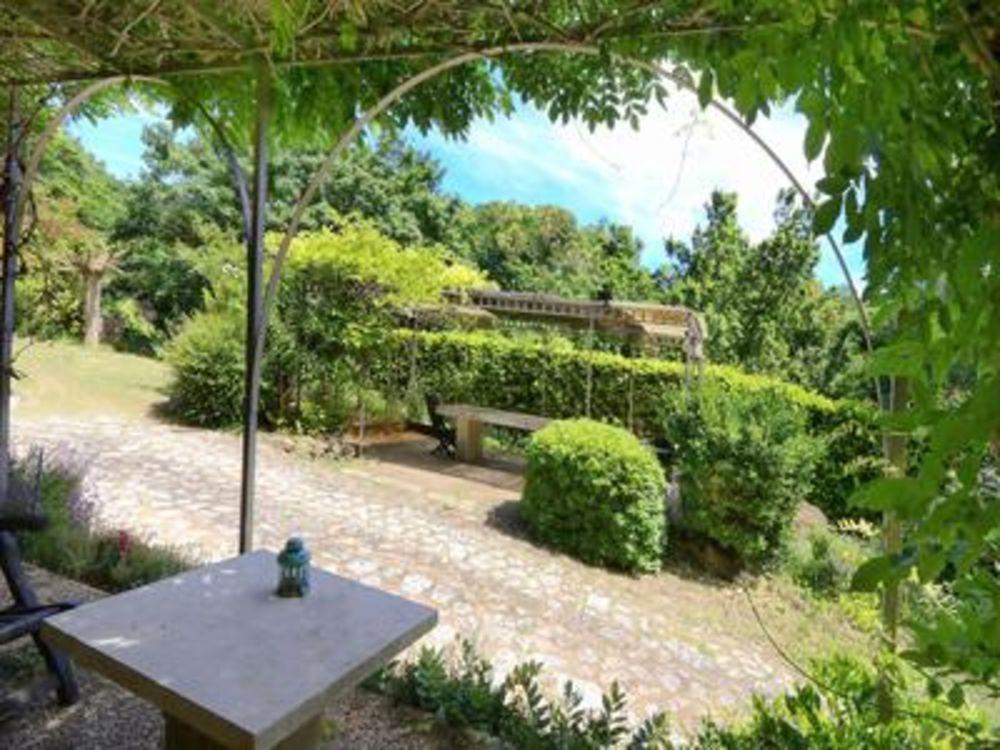 Vente Villa RUSTREL - Jolie maison magnifiquement situé dans un petit paradis de verdure dans les ocres.  à Rustrel