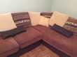 Gros canapé d'angle marron en cuir et textile Meubles